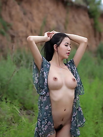 Young-looking female in sexy dress